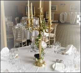 Gold 80cm Candelabra with flower Garland to hire | Wedding | Events | Carlisle | Round Thorn Hotel Penrith Cumbria | Tithe Barn | Rustic Hessian Wedding